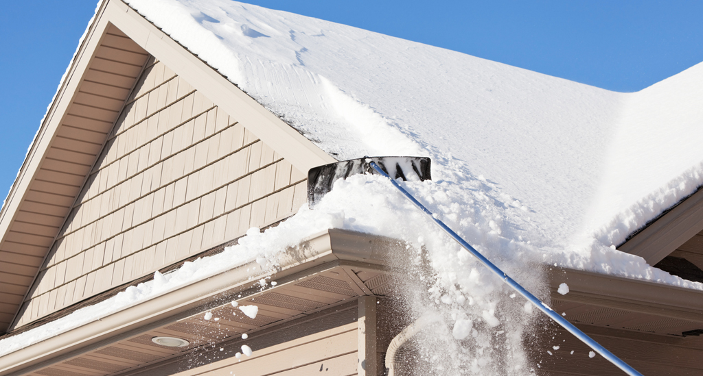 How To Safely Remove Snow From Your Roof Flynn Roofing